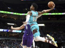 Memphis Grizzlies rookie sensation, Ja Morant, tomahawks a dunk against the Charlotte Hornets. (Image: Karen Pulfer Focht/AP)