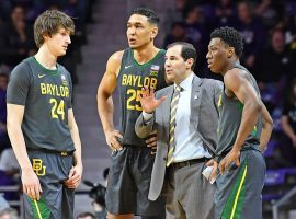 Baylor Bears head coach Scott Drew advises his team during a time out in a recent game against Kansas State. (Image: Peter Aiken/Getty)
