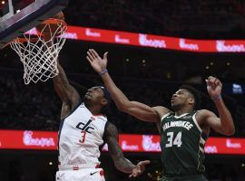 Washington Wizards guard Bradley Beal drives to the basket with Giannis Antetokounmpo of the Milwaukee Bucks in hot pursuit at Capital One Arena in Washington, DC. (Image: Marco Esquondoles/Getty)