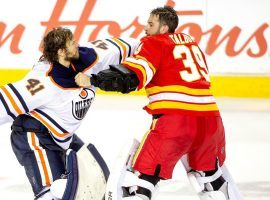 Edmonton Oilers Goalie Mike Smith (white) fights Calgary Flames goalie Cam Talbot at the Saddledome in Calgary, Alberta, Canada. (Image: Derek Leung/Getty)