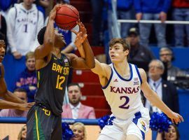 Baylor guard Jared Butler (12) defended by Kansas guard Christian Braun in Lawrence, Kansas. (Image: Jay Biggerstaff/USA Today Sports)