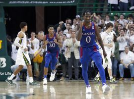 Kansas guard Marcus Garrett (0) celebrates a big win over #1 Baylor at Ferrell Center in Waco, TX. (Image: Kevin Jairaj/USA Today Sports)