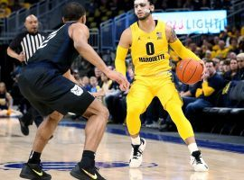 Marquette guard Markus Howard is defended by Butler's Aaron Thompson in a game at Fiserv Forum in Milwaukee, WI. (Image: Dylan Buell/Getty)