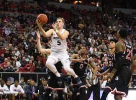 Utah State guard Sam Merrill beats several Fresno State defenders to the basket during the 2019 Mountain West Tournament in Las Vegas, NV. (Image: Justin Tafoya/AP)