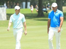 Rory McIlroy, left, took over the No. 1 ranking in golf over Brooks Koepka on Sunday. (Image: Getty)
