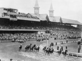 More than 70,000 fans watch horses hit the first turn at Churchill Downs in the 1945 Kentucky Derby. Pushed back to June 9 because of World War II restrictions, that Derby was the last time the Run for the Roses didn't run in May. (Image: AP File Photo)
