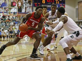 Georgia guard, Anthony Edwards, double-teamed by Michigan State in the Maui Classic. (Marco Garcia/AP)