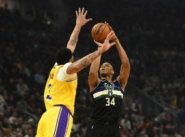 LA Lakers Anthony Davis defends a 3-point shot from Milwaukee Bucks center Giannis 'Greek Freak' Antetokounmpo in Milwaukee, WI. (Image: Stacey Revere/Getty)