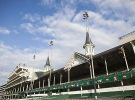 The twin spires of Churchill Downs could stand guard over an empty infield and grandstand the first Saturday in May. Officials plan to make an announcement on the Kentucky Derby's status this week (Image: Yahoo News)