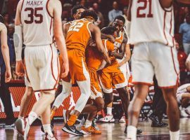 Texas players mob Matt Coleman after he hit a game-winning 3-pointer at the buzzer to loft Texas over Oklahoma in Austin. (Image: Texas Athletics)