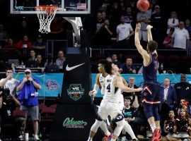 St. Mary's guard Jordan Ford knocks down the game-winner to defeat BYU in the WCC tournament semifinals at the Orleans Arena in Las Vegas. (Image: Isaac Brekken/AP)