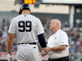 New York Yankees RF Aaron Judge with trainer Steve Donahue during a game in 2018 at Yankee Stadium in the Bronx. (Image: Elsa/Getty)