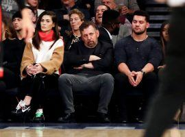 Billionaire James Dolan slumps in his courtside seat at Madison Square Garden during a Knicks games in 2019. (Image: Frank Franklin II/AP)