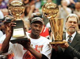 Michael Jordan and head coach Phil Jackson celebrate their victory in the 1998 NBA Finals. (Image: Jeff Haynes/Getty)