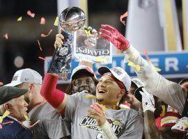 Kansas City Chiefs quarterback, Patrick Mahomes. hoists the Super Bowl trophy after winning Super Bowl LIV. (Image: AJ Mast/Getty)