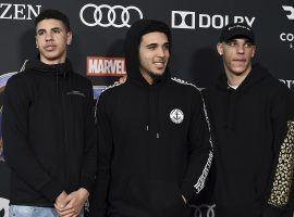 LeMelo (left), LiAngelo (center), and Lozno Ball (right) all sign with Jay-Z's sports agency, Roc Nation. (Image: Jordan Strauss/AP)