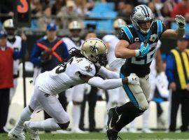 Carolina Panthers RB Christian McCaffrey evades a tackler on the New Orleans Saints at the Superdome. (Image: Streeter Lecka/Getty)