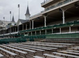 While racing will soon return to Churchill Downs, the surreal sight of empty stands will stick around for the foreseeable future. (Image: Pat McDonogh: Courier-Journal)