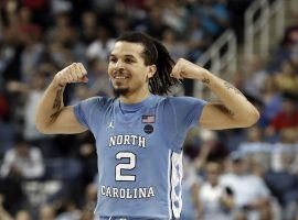 North Carolina guard Cole Anthony flexes after hitting a 3-pointer early in the 2019-20 season. (Image: Gerry Broome/AP)