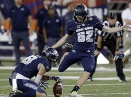 Utah State kicker Dominik Eberle connects on a field goal against New Mexico State in the Arizona Bowl. (Image: Rick Scuteri/AP)