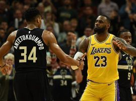 Milwaukee Bucks big man Giannis Antetokounmpo and LA Lakers star LeBron James dap before tipoff at Staples Center in Los Angeles. (Image: Kevork Djansezian/Getty)