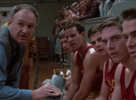Coach Norman Dale (Gene Hackman) with his Hickory players during a timeout in 'Hoosiers' (1986). (Image: Orion Pictures)