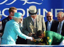 Queen Elizabeth II presents winning jockey Eurico Rosa Da Silva with the Queen's Plate at Woodbine in 2010. (Image: Michael Burns Photo Ltd.)