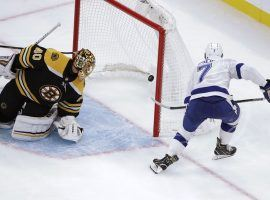 Tampa Bay Lightning winger Mathieu Joseph scores a goal against Boston Bruins goalie Tukka Rask. (Image: Elise Amendola/AP)