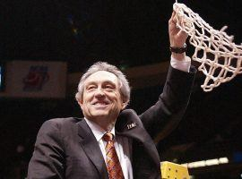 Eddie Sutton, then coach of the Oklahoma State Cowboys, cuts down the net after advancing to the Final Four in 2004. (Image: Oklahoma State Athletics)