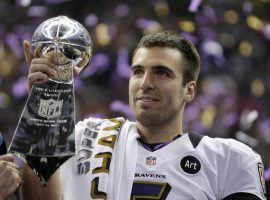 Joey Flacco, QB for the Baltimore Ravens, holds up the Lombardi Trophy after winning Super Bowl XLVII in 2013. (Image: Matt Slocum/AP)