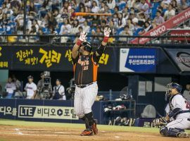 Choi Jun-seok, power hitter for the Lotte Giants, flips his bat after a home run in a 2015 KBO game. (Image: Jean Chung/New York Times)