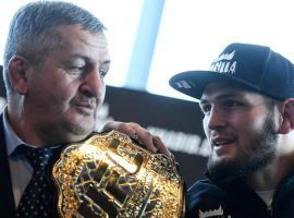 Khabib Nurmagomedov (right) confirmed that his father (left) remains hospitalized due to COVID-19. (Image: AFP)