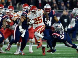 Kansas City RB LeSean McCoy rumbles for a first down against the New England Patriots in Foxboro, MA. (Image: Jill Toyoshiba/KC Star)