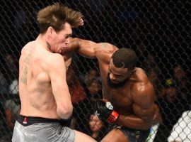 Tyron Woodley (right) throws a punch during his win over Darren Till (left) in the main event of UFC 228 on Sept. 8, 2018. (Image: Josh Hedges/Zuffa/Getty)