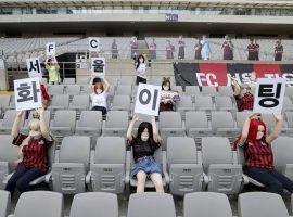 The South Korean football team FC Seoul had sex dolls dressed in team colors as fans for their match against Gwangju FC (Image: Ryu Young-suk/AP)