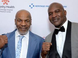 Evander Holyfield, right, has been training for a comeback fight, and said it might occur with former nemesis Mike Tyson. (Image: Getty)