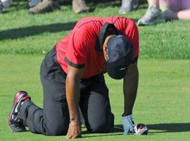Tiger Woods drops to his knees in pain at a tournament. Woods said running caused major damage to his body over the years. (Image: Getty)