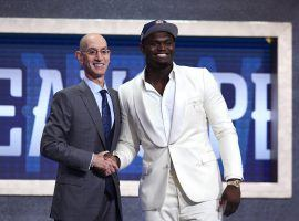 NBA commish Adam Silver congratulates Zion Williamson for becoming the #1 pick in the 2019 NBA Draft via the New Orleans Pelicans. (Image: Sarah Stier/Getty)