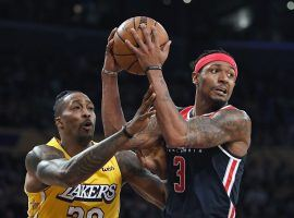 Washington Wizards guard Bradley Beal defended by LA Lakers center Dwight Howard in 2019. (Image: Mark J. Terrill/AP)