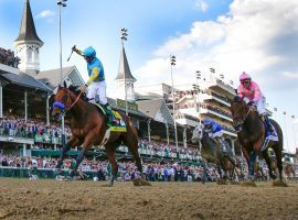 The image of a Kentucky Derby winner -- like Victor Espinoza aboard American Pharoah in 2015 - was absent from May due to the coronavirus. That impacted horse racing betting handles for the month. (Image: Mark Cornelison/Lexington Herald via Getty)