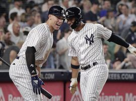 NY Yankees RF Aaron Judge congratulates SS Gleyber Torres after hitting a home run in Yankee Stadium in the Bronx, NY. (Image: Julie Jacobson/AP)