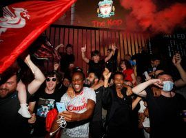 Liverpool supporters celebrated Thursday night after the club clinched its first Premier League ever and its first English league crown in 30 years. (Image: Phil Noble/Reuters)