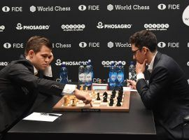 Magnus Carlsen (left) and Fabiano Caruana (right) will face off in the Chessable Masters quarterfinals, a rematch of their 2018 World Championship match. (Image: Facundo Arrizabalaga/EPA)