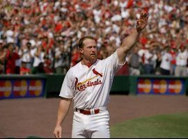 Cardinals 1B Mark McGwire acknowledging the crowd at Busch Stadium in St. Louis after he hit home run #62 in 1998. (Image: Getty)