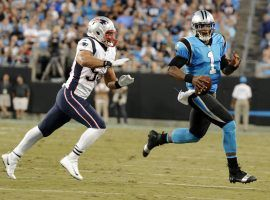 New England Patriots Linebacker Kyle Van Noy pursues Carolina Panthers QB Cam Newton in 2018 in Charlotte, NC. (Image: Mike McCarn/AP)