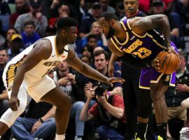New Orleans Pelicans rookie Zion Williamson guards LeBron James of the LA Lakers at the Smoothie King Center in NOLA. (Image: Porter Lambert/Getty)