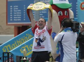 Joey Chestnut will be going for his 13th Mustard Belt in the Nathan's Famous Hot Dog Eating Contest, but there will be no crowds to cheer him on because of the COVID-19 global pandemic. (Image: Getty)