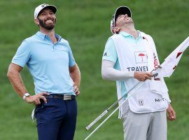 Dustin Johnson and his caddy share a laugh during Sunday's final round of the Travelers Championship. (Image: Getty)