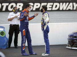 Joey Logano and Chase Elliott meet in the infield at theSupermarket Heroes 500 after the two were involved in a crash. (Image: AP)