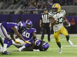 Green Bay packers running back, Aaron Jones, evades the Minnesota Vikings defense during a game at US Bank Stadium in Minneapolis. (Image: Craig Lassig/AP)